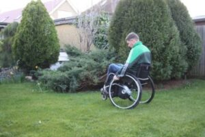 Moving Wheelchair Over Grass